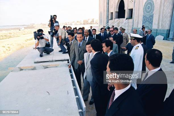 Japanese Crown Prince Naruhito visits the construction site of the Hassan II Mosque with Crown Prince Mohammed of Morocco and Prince Moulay Rachid on...