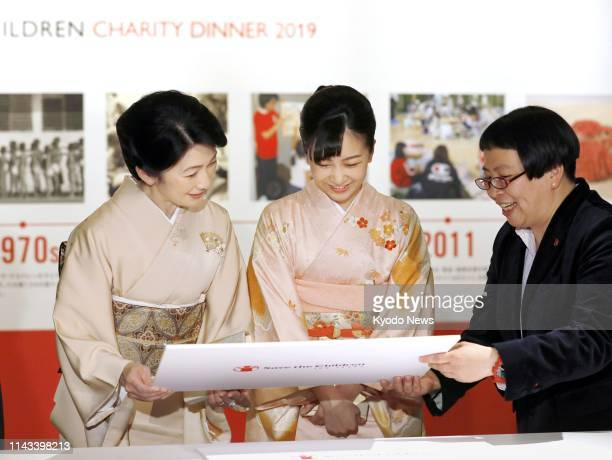 Japanese Crown Princess Kiko and her daughter Princess Kako attend an exhibition highlighting activities of the international nongovernmental...