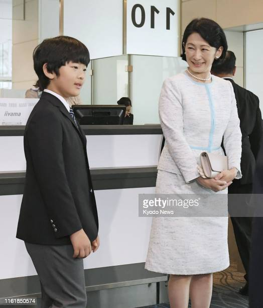 Japanese Crown Princess Kiko and her son Prince Hisahito are pictured at Tokyo's Haneda airport on Aug 16 before leaving for a private family trip to...