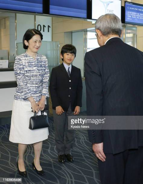 Japanese Crown Princess Kiko and her son Prince Hisahito are pictured upon their arrival at Tokyo's Haneda airport on Aug 25 following a weeklong...