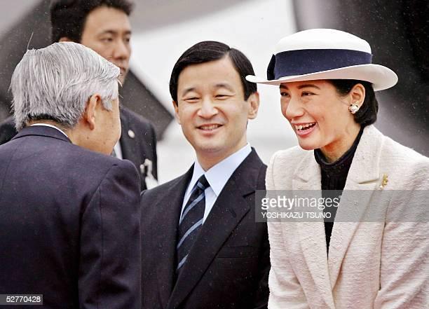 Japanese Crown Princess Masako and Emperor Akihito exchange farewell greetings while Crown Prince Naruhito smiles at the Tokyo International Airport...