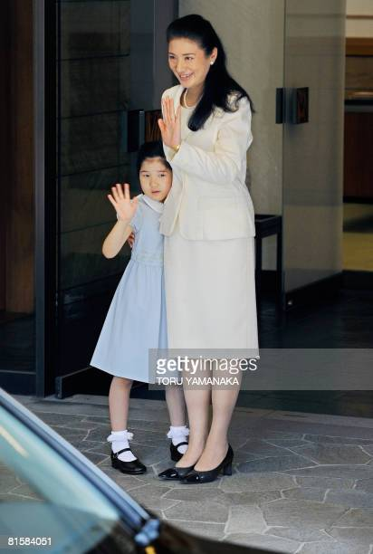 Japanese Crown Princess Masako and her daughter Princess Aiko wave to Crown Prince Naruhito at the entrance of the Togu Palace in Tokyo on June 16...
