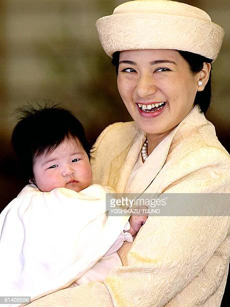 Japanese Crown Princess Masako holding her baby Princess Aiko in her arms smiles as they leave their residence Togu Palace in Tokyo to visit the...