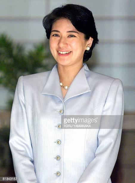 Japanese Crown Princess Masako smiles as she comes out to greet her husband, Crown Prince Naruhito , upon his arrival at an entrance of Akasaka...