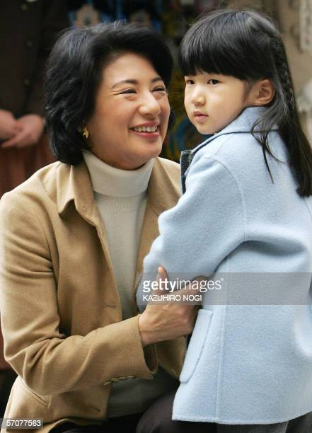 Japanese Crown Princess Masako soothes her daughter Princess Aiko as they are welcomed by Disney charactors upon arrival at Tokyo DisneySea in...