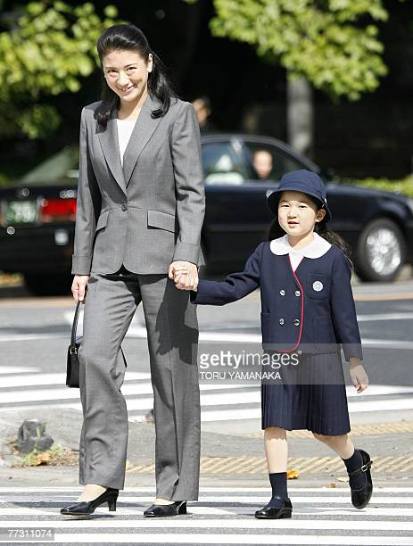 Japanese Crown Princess Masako walks with her daughter Princess Aiko hand in hand as they head for Gakushuin Elementary School to watch the annual...