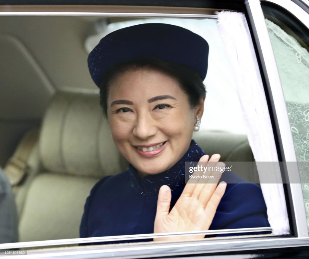japanese-crown-princess-masako-waves-as-she-enters-the-imperial-in-picture-id1074621630
