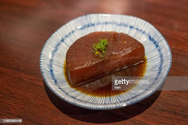 japanese cuisine oden, stewed radish - dikon radish stock photos and pictures
