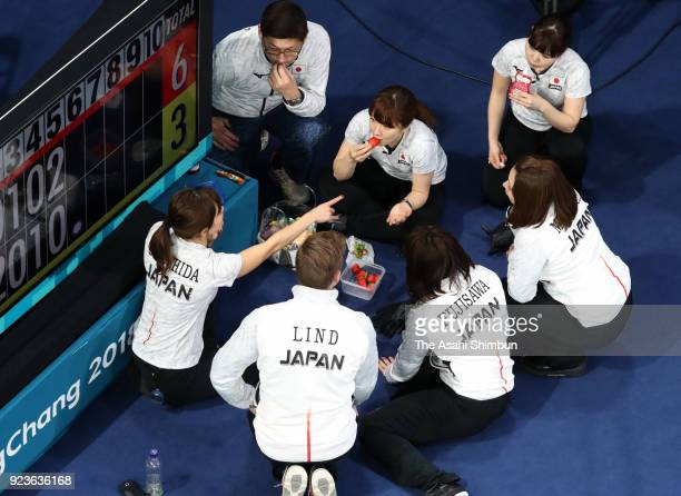 Japanese curlers and coaches are seen during the Curling Women's Semi Final match between South Korea and Japan on day fourteen of the PyeongChang...