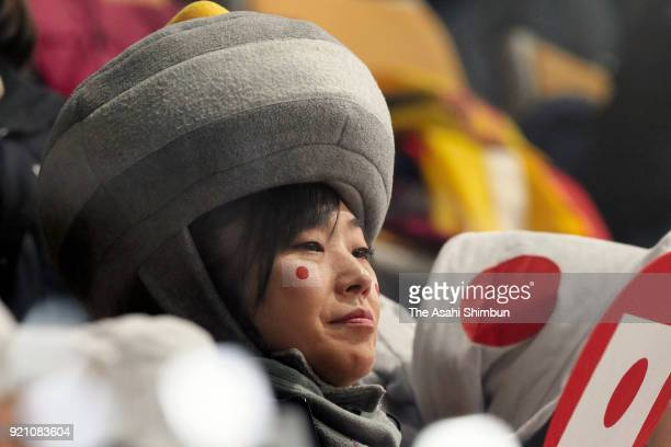A Japanese curling fan wearing a stoneshaped hat is seen during Curling Men's Round Robin session 10 against Canada on day eleven of the PyeongChang...