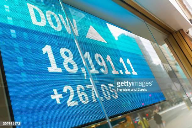 Japanese currency data screen in window, New York, USA