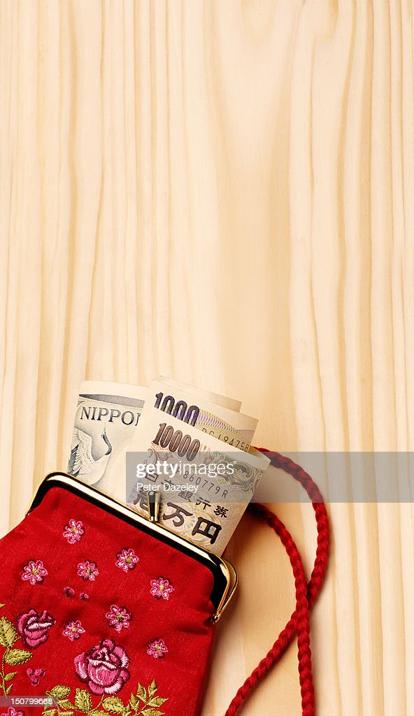 Japanese currency in a purse : Stock Photo