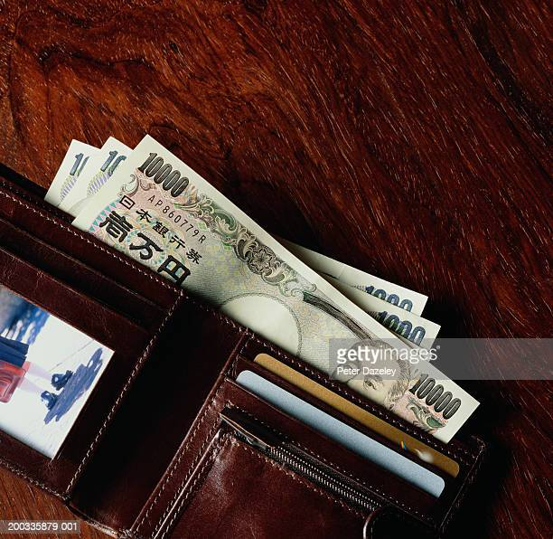japanese currency in wallet - japanese yen note stock photos and pictures