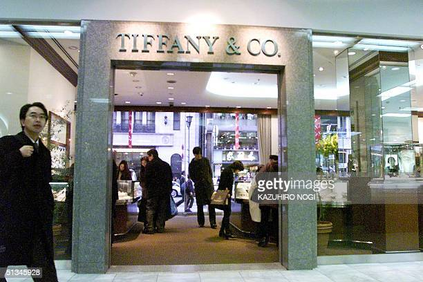 Japanese customers buy jewelry at a Tiffany shop which is located in Japan's Mitsukoshi department store at downtown Tokyo 08 January. Mitsukoshi,...
