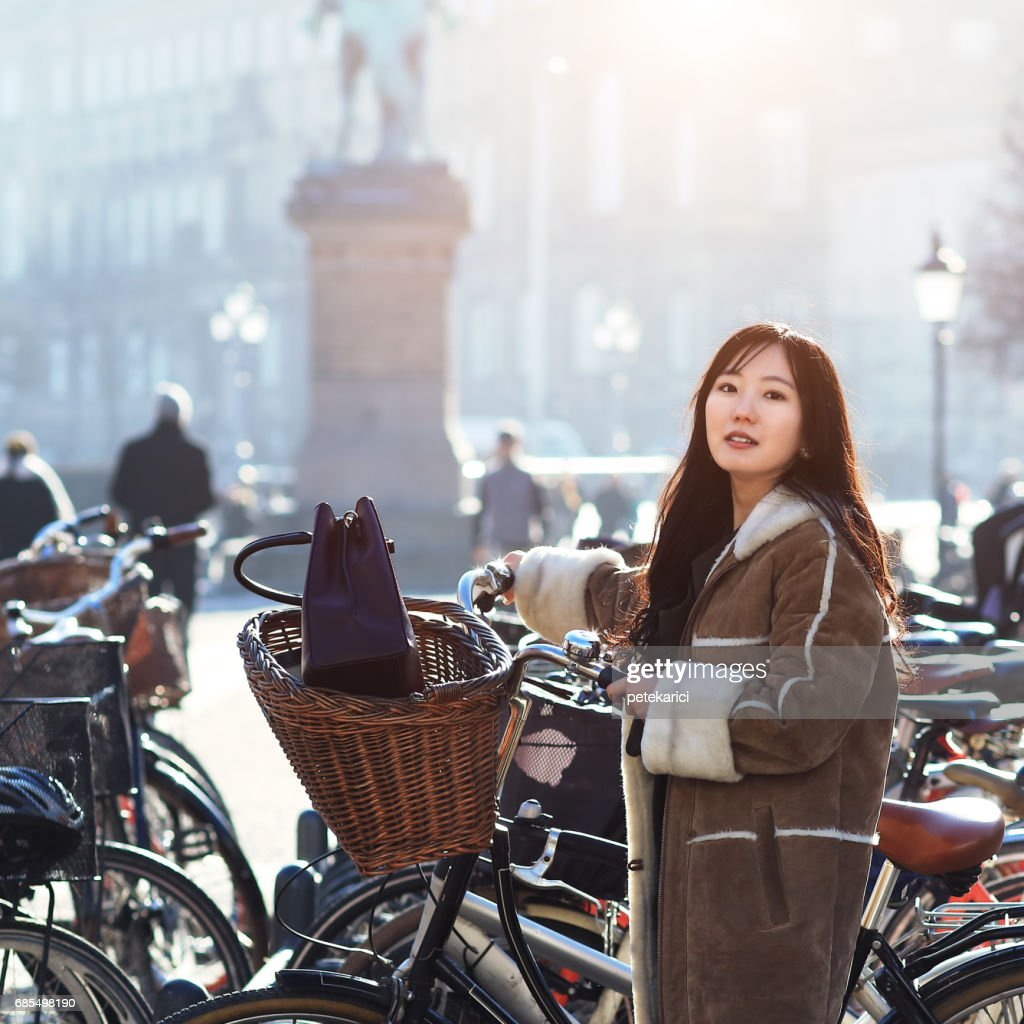 Japanese cyclist in Copenhagen, Denmark : Stock Photo