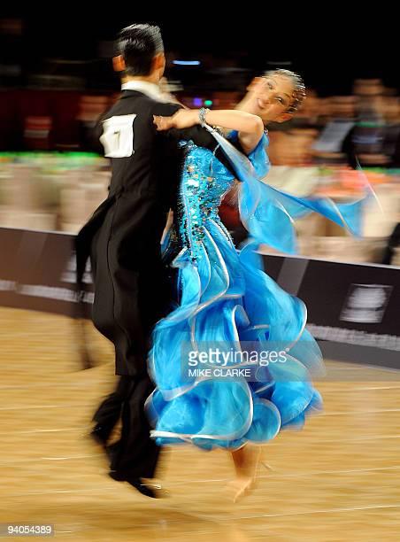 Japanese dancers Ayami Kubo and Masayuki Ishihara perform the quickstep during the dancesport event at the 2009 East Asian Games in Hong Kong on...