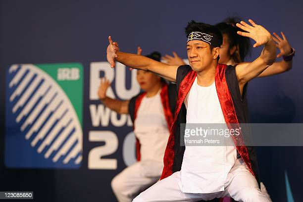 Japanese dancers perform prior to members of the Japan IRB Rugby World Cup 2011 team arrive at Auckland International Airport on August 31 2011 in...