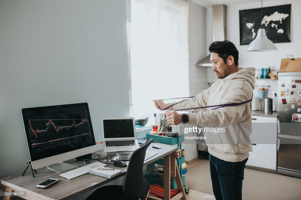 Japanese day trader talking with clients on conference call : Stock Photo