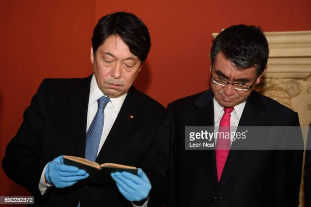 Japanese Defence Minister Itsunori Onodera and Japan's Foreign Minister Taro Kono examine a selection of historical naval artifacts in the Queen's...