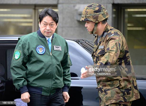 Japanese Defence Minister Itsunori Onodera is escorted by a commander of Patriot Advanced Capability3 missile corps as he inspects PAC3 missile...