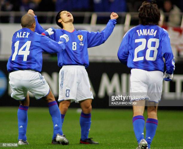 Japanese defender Alessandro Santos and forward Keiji Tamada join midfielder Mitsuo Ogasawara celebrate his first goal during the 2006 FIFA World Cup...