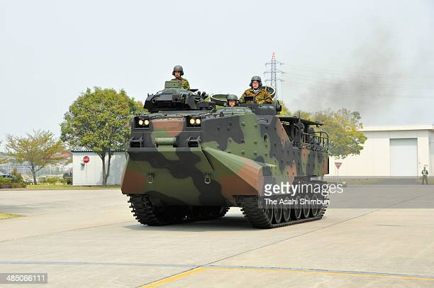 Japanese Defense Minister Itsunori Onodera inspects the Ground SelfDefense Force amphibious vehicle at the JGSDF Kasumigaura Base on April 16 2014 in...
