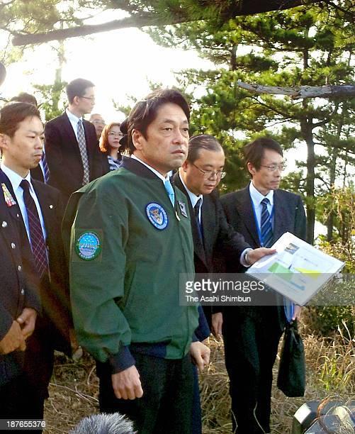 Japanese Defense Minister Itsunori Onodera inspects the Japan Air SelfDefense Force Kyogamisaki Sub Base on November 9 2013 in Kyotango Kyoto Japan...