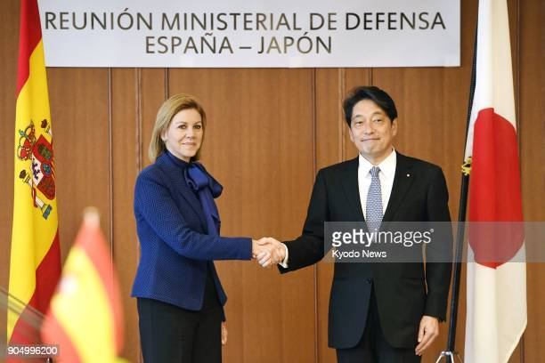 Japanese Defense Minister Itsunori Onodera shakes hands with his Spanish counterpart Maria Dolores de Cospedal during their meeting at the Japanese...