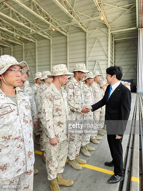 Japanese Defense Minister Itsunori Onodera shakes hands with members of the SelfDefense Force who deploy to cope with pirates at the Red Sea and...