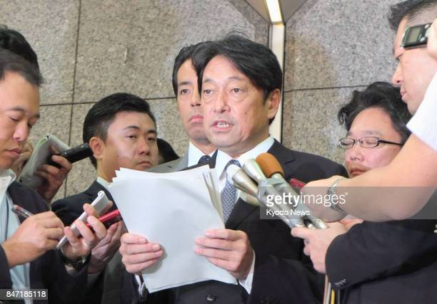 Japanese Defense Minister Itsunori Onodera speaks to reporters in Tokyo on Sept 15 after North Korea launched another ballistic missile over the...