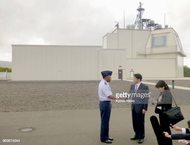 Japanese Defense Minister Itsunori Onodera visits a test complex of the landbased Aegis Ashore missile defense system on the Hawaiian island of Kauai...