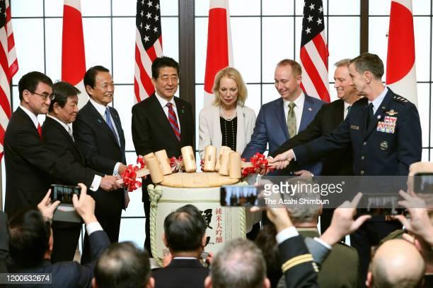 Japanese Defense Minister Taro Kono, Foreign Minister Toshimitsu Motegi, Vice Prime Minister Taro Aso, Prime Minister Shinzo Abe, Mary Eisenhower,...
