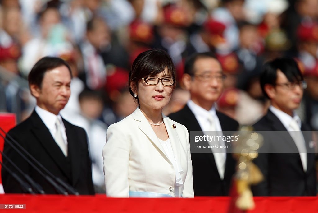 Japanese Defense Minister Tomomi Inada reviews troops of the Self Defense Forces marching during the annual review at the Japan Ground Self-Defense Force Camp Asaka on October 23, 2016 in Asaka, Japan.