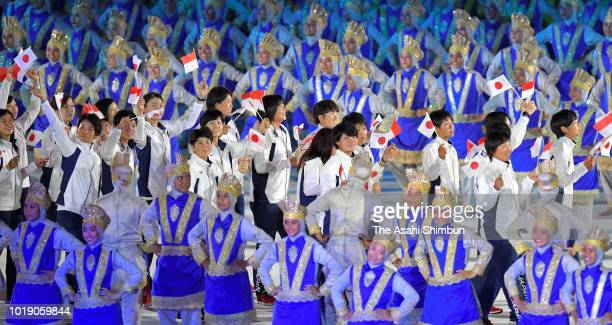 Japanese delegation enter the stadium during the opening ceremony of the Asian Games 2018 at Gelora Bung Karno Stadium on August 18 2018 in Jakarta...