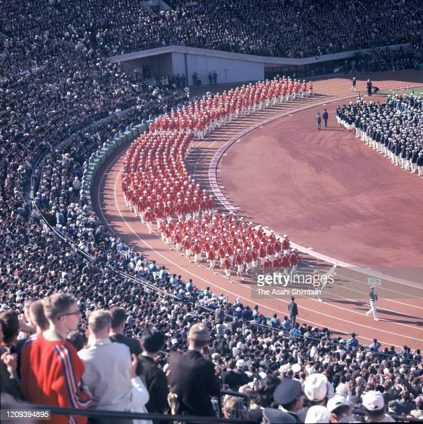 Japanese delegation enter the stadium during the opening ceremony of the Tokyo Olympic Games at the National Stadium on October 10, 1964 in Tokyo,...