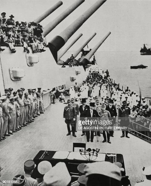 Japanese delegation, led by Minister Mamoru Shigemitsu, approaching the table to sign the surrender aboard the US battleship USS Missouri, September...