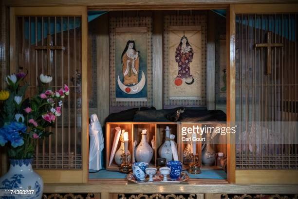 Japanese depictions of the Virgin Mary are displayed in a shrine in the home of Masaichi Kawasaki whose grandfather was converted to Catholicism by...