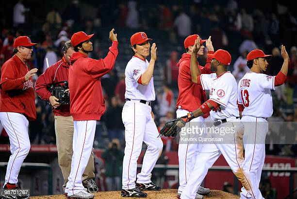 Japanese designated hitter Hideki Matsui of the Los Angeles Angels of Anaheim high five teammate Torii Hunter after defeating Cleveland Indians on...