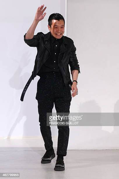 Japanese designer Arashi Yanagawa acknowledges the public after the John Lawrence Sullivan Fall/Winter 2014/2015 men's fashion show in Paris on...