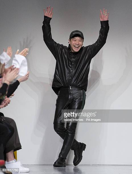 Japanese designer Arashi Yanagawa acknowledges the public after the JOHN LAWRENCE SULLIVAN London Fashion Week Men's AW17 show held at BFC Show Space...