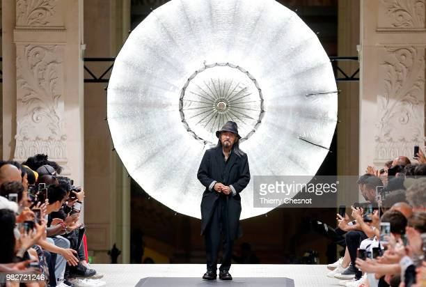 Japanese designer, Yohji Yamamoto acknowledges the audience at the end of the Y-3 Menswear Spring/Summer 2019 show as part of Paris Fashion Week on...