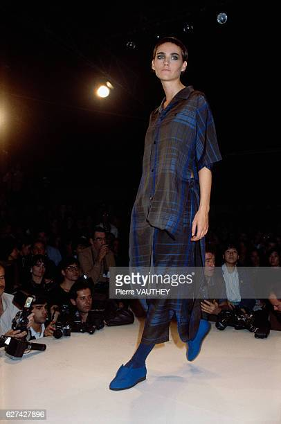 Japanese designer Yohji Yamamoto shows his 1985 spring-summer women's ready-to-wear line in Paris. The model is wearing blue and black striped pants...