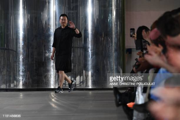 Japanese Designer Yosuke Aizawa acknowledges the audience at the end of his Withe Mountaineering men's spring/summer 2020 fashion collection on June...