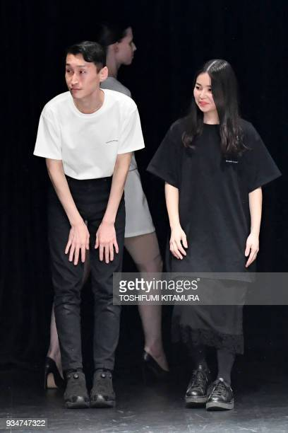 Japanese designers Takeshi Kitazawa and Emiko Sato of fashion brand DressedUndressed thank their guests at the end of their 2018 autumn/winter...
