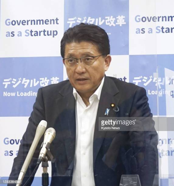 Japanese Digital Transformation Minister Takuya Hirai speaks at a press conference in Tokyo on June 11 admitting he instructed officials to coerce...