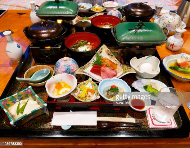 japanese diner served for two people in a traditional japanese hotel (ryokan) - 煮物 ストックフォトと画像