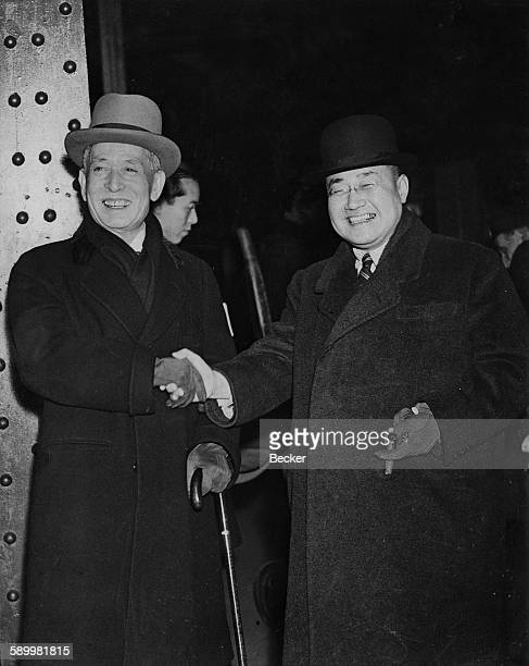 Japanese diplomat Ishii Kikujiro Japan's special envoy to Europe arrives at Victoria Station in London and is greeted by Shigeru Yoshida the Japanese...