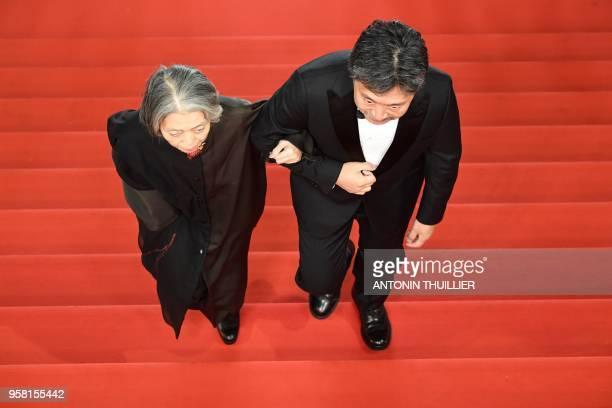 Japanese director Hirokazu KoreEda and Japanese actress Kirin Kiki arrive on May 13 2018 for the screening of the film Shoplifters at the 71st...