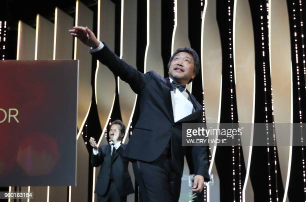Japanese director Hirokazu KoreEda celebrates on stage after he was awarded with the Palme d'Or for the film 'Shoplifters ' on May 19 2018 during the...