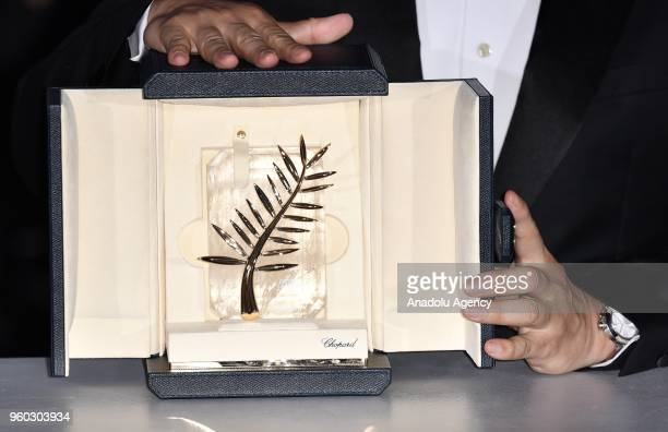 Japanese director Hirokazu Koreeda poses during the Award Winners photocall after winning the Palme d'Or award for 'Shoplifters' at the 71st Cannes...
